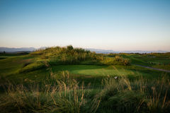 Golf course with collar at sunset Royalty Free Stock Images