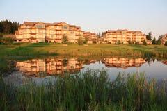 Golf Course Condos. A group of luxury condominiums overlooking a golf course water hazard Royalty Free Stock Photos