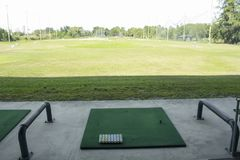Golf course driving range,Golf ball ready for drive in driving r Stock Photo