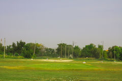 Golf course driving range. Old golf course driving range,Golf ball Stock Photography