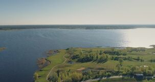 Golf course drone flight 4k, lake, bridge landscape, summer, above, lifestyle, beautiful. Golf course drone sport, water, field, tree, fairway hole overhead stock video