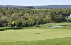Golf course fairway. A fairway at the Southmoore Golf course in Bath, Pennsylvania. Far in the background are the Blue Mountains stock photo