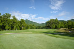 Golf Course Fairway and Blue Sky Mountain View Stock Photo