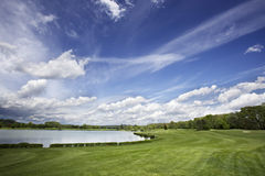 Golf course fairway and fantastic sky Royalty Free Stock Photos