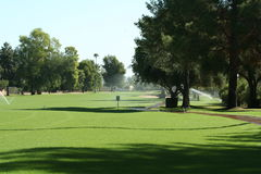 Golf course fairway with irrigation. Royalty Free Stock Photography