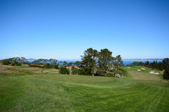A golf course fairway. With a view and sand bunkers in the distance Royalty Free Stock Photo