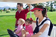 Golf course family father mother daughters buggy Royalty Free Stock Photo