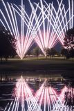 Golf Course Fireworks Display. Vivid fireworks display over a golf course. Reflection in water hazard stock photography