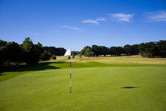 Golf course with a flag Royalty Free Stock Images