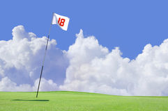 Golf course flag at hole 18. The 18th hole on the putting green at a golf course royalty free stock images