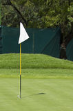 Golf Course Flag - Hole Marker - Pin. A flag pole used to demarcate the current positioning of the hole, on the putting surface [green] of a golf course Stock Photo