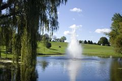 Golf Course Fountain And Pond Stock Image