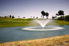 Golf Course. With fountain (long exposure Royalty Free Stock Images