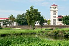 Golf course in front Intramuros wall and Lyceum University stock photography