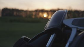 Golf course, golf bag. At sunset stock video