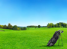 Golf course with golf bag Royalty Free Stock Image