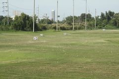 Golf course and golfballs on driving range,view of a golf course Stock Photos