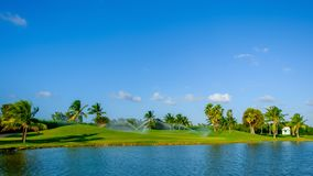 Grand Cayman-Golf Course 5. Golf course on Grand Cayman by the Caribbean Sea being watered, Cayman Islands royalty free stock images