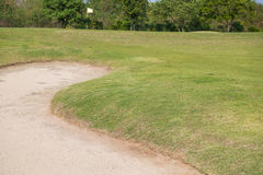 golf course - green golf field and sand pit. Stock Photo