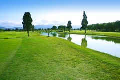 Golf course green grass field lake reflection. Golf course green grass field lake trees reflection Stock Photography