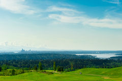 Golf Course with Green Grass and Seattle Downtown at the Backgro Royalty Free Stock Image
