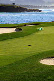 Golf course green by the ocean. This is a Golf course green with ocean in the background Royalty Free Stock Photography