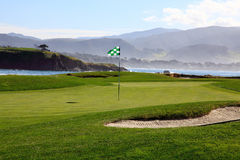 Golf course green by the ocean. This is a Golf course green with ocean in the background Royalty Free Stock Photo