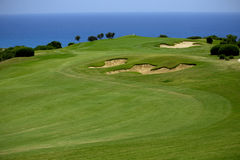 Golf Course on Green Ocean Shore Stock Photo