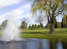 Golf Course Hazard. The golf course fountain hazard is nice to look at but it catches many of the golfers balls. Spring in Wisconsin Royalty Free Stock Images