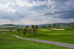 Golf course on the hills Royalty Free Stock Photos