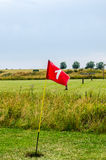 Golf course hole flag Stock Photography