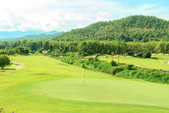 Golf course landscape. Beautiful green golf course landscape, Golfing resort at Lamphun Province, Thailand royalty free stock photo