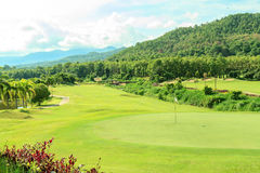 Golf course landscape. Beautiful green golf course landscape, Golfing resort at Lamphun Province, Thailand stock photography