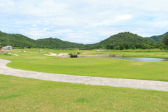 Golf course landscape. Beautiful golf course landscape with sky and clouds Royalty Free Stock Images