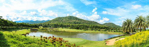 Golf course landscape panorama. Beautiful green golf course landscape panorama, Golfing resort at Lamphun Province, Thailand royalty free stock images