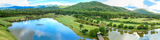 Golf course landscape panorama. Beautiful green golf course landscape panorama, Golfing resort at Lamphun Province, Thailand royalty free stock image
