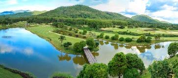 Golf course landscape panorama. Beautiful green golf course landscape panorama, Golfing resort at Lamphun Province, Thailand stock photos