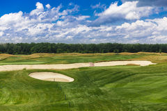 Golf course landscape with sand bankers. Royalty Free Stock Photo