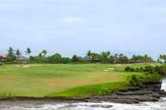 Golf course in luxury resort. Green field and blue sky Stock Images