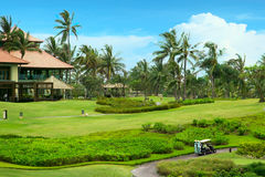 Golf course in luxury resort. Green field and blue sky