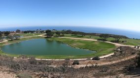 Golf course Malibu. Panoramic aerial view of the Pacific Coast in California. Golf course of University in Malibu, United States. The main campus on the hills stock video footage