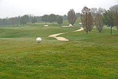 Golf course in the morning with autumn mist . Golf course in the morning with autumn mist Stock Photography