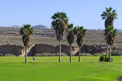 Golf course with mountain view stock photography