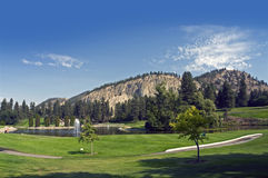 Golf Course by mountains stock photography