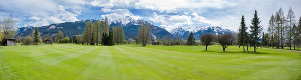 Golf course in mountains royalty free stock photo
