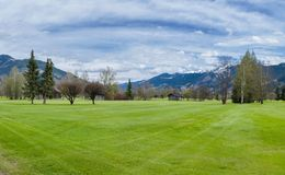 Golf course in mountains Stock Image