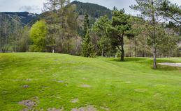 Golf course in mountains Stock Photography
