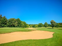 Golf course, natural green meadow, blue sky Royalty Free Stock Image