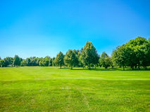 Golf course, natural green meadow, blue sky Stock Images