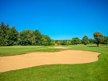 Golf course, natural green meadow, blue sky Royalty Free Stock Photo